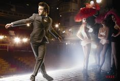 "Daniel Radcliffe dances on stage at the Theatre Royal Drury Lane in a Annie Leibovitz shoot for Vogue magazine to promote his upcoming role in the Broadway production of ""How To Succeed In Business Without Really Trying."" Photography by Annie Leibovitz for ""Best in Show"" editorial, Vogue March 2011."