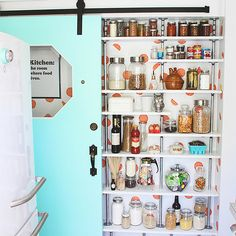 Cute Mini Pantry with Pipe Shelves and Sliding Door