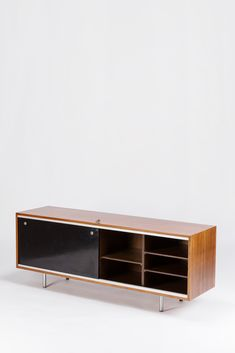 George Nelson; Walnut, Aluminum, Chromed Metal and Formica Sideboard for Herman Miller, 1960s.