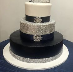 Navy and Silver wedding cake with silver confetti and rhinestone ribbon