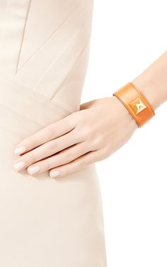 Hermes Orange Leather Wide Stud Bracelet by What Goes Around Comes Around for Preorder on Moda Operandi