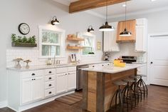 Hosts Chip and Joanna Gaines have done it again! Definitely one of their most impressive makeovers to date, this kitchen went from danger zone to dazzling. White cabinetry and light gray walls create a warm, cheery environment, while a stunning handmade island takes center stage.