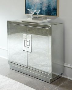 """Contemporary handcrafted mirrored cabinet. Made of wood composite and glass. Antique, beveled mirror facets. Chrome pulls. Two doors and three interior shelves (one adjustable). 42""""W x 14""""D x 38""""T. Im"""