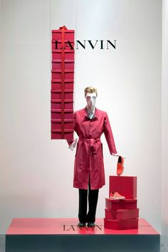 the Lanvin store fronts on Faubourg Saint-Honoré adorned with masks of anonymity #Lanvin125