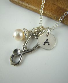 Stethoscope Pendant Necklace, Initial Necklace, Personalized Jewelry, Silver Charms, Doctor, Medicine, Medical School Graduation Gift. $36.00, via Etsy.