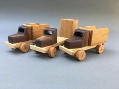 Like our Old Timer Dump Truck,this sturdy truck features a functional dump bed perfect for dropping off loads but is considerably lighter and smaller. Available in natural wood (Oak and Walnut) with a non toxic oil and wax L x 3 W x 3 H Weight 11 oz. Wooden Toy Trucks, Wooden Car, Wooden Train, Toy Art, Wood Projects, Woodworking Projects, Wood Boat Plans, Sailboat Plans, Handmade Wooden Toys