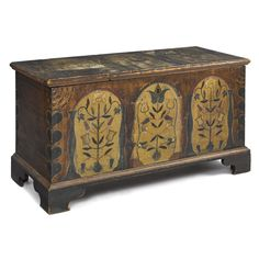 "Pennsylvania or Southern painted poplar dower chest, ca. 1800, the lid with three tombstone panels adorned with tulips and birds, over a case with similar decoration flanked by heart corners, all on an ochre sponged ground, supported by bracket feet, 25"" h., 46 1/4"" w."