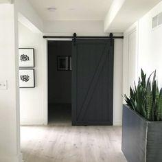 Iron Ore SW 7069 - Neutral Paint Color - Sherwin-Williams Iron Ore Sherwin Williams, White Paint Colors, Neutral Paint, Black Interior Doors, Barn Door Designs, Black Barn, New Homes, House Design, Hardware