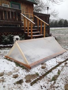 Cold frame for growing winter greens at Easy Tiger Permaculture Farmstead in Tennessee.