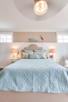 Coastal Bedroom in light blue and sandy beige.