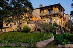 A tribute to the past, this elegant and impressive Mediterranean villa is perched on the hill above the boulevard in Saint Francis Wood, San Francisco, California