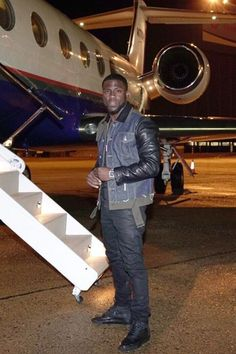 Kevin Hart wearing  Balenciaga Multi-Panel High-Top Trainers, Dsquared2 Mixed Media Denim/Leather Jacket, Audemars Piguet Royal Oak Chronograph