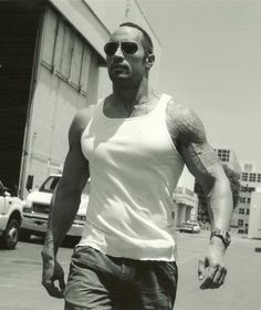 Dwayne Johnson Born on: May 1972 Sexy because: he's the Rock, duh! And besides that buff body, he's got an adorable smile and an obvious sense of humor. The Rock Dwayne Johnson, Dwayne The Rock, Rock Johnson, Michelle Rodriguez, Vin Diesel, Paul Walker, Gal Gadot, Gorgeous Men, Beautiful People