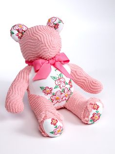 Lovable overstuffed one-of-a-kind chenille teddy bear. Sure to be your little cuddle bear's snuggly friend for years to come. Handmade in the United States of new and vintage materials.