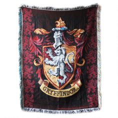 One of my favorite discoveries at HarryPotterShop.com: Harry Potter Exclusive Gryffindor Crest Tapestry Throw