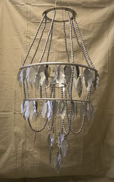 Silver feather chandelier by Bramble Workshop