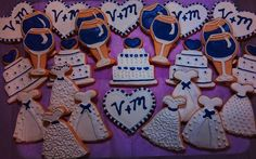 Decorated Bridal shower Cookies for a theme party at a wine cellar. bridal dresses, cakes, hearts and wine glasses.