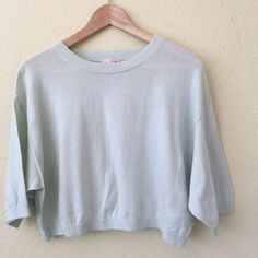 GAP cropped loose cotton sweater EUC - only worn a few times! Although it looks light blue in the photos, it's actually a soft mint green. Very lightweight and breezy. Sized an XS, but definitely works for a small also. Great over a tank or sleeveless collared shirt. Also PERFECT with a cute high waist pencil skirt! GAP Sweaters Crew & Scoop Necks
