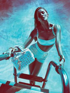 Versace Woman – Versace recently released its complete spring 2012 campaign starring Gisele Bundchen in form-fitting designs from the Italian label. Captured by Mert & Marcus with art direction by Giovanni Bianco, Gisele looks like a sea siren in these sultry blue images taken in Palm Springs, California. / Styling by Joe McKenna