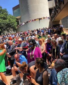 Dallas stands together at Thanksgiving Square.