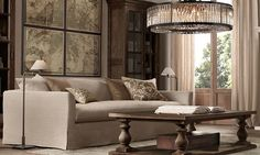 put a console table behind sofa, put large art above it, bookcases on either sides with two floor lamps. no side tables