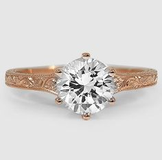 Intricate hand-engravings and subtle borders of milgrain adorn this sensational vintage-inspired ring. The elegant band gently broadens toward the brilliant center diamond, producing a stunning effect.