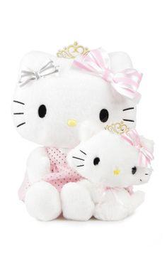 A sweet Hello Kitty Plush holds a supercute Charmmykitty plush making this a beautiful pair!