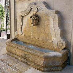 Antique and reproduction fountains, hand crafted in limestone by artisans in Provence, France.