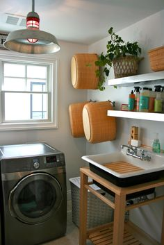 I SO want to redo our laundry area! Love the kohler sink. Click through to see the other amazing details too. LOVE