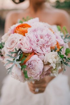 Pink bouquet with orange accents