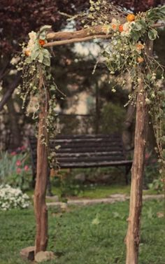 Rustic Wedding Arches | Wedding arch flowers at corners.