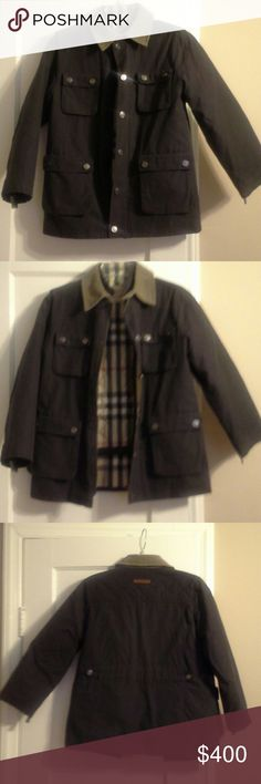 Burberry Boy's Authentic Coat...Sz: 10Y... $595 Excellent Condition Preowned.....  Sz: 10Y  100% Authentic  Purchased at Nordstroms  Hardly Worn....Retails: $595  Coat is heavy weight....Has Hidden Zipper & Snap Closures....Has signature Burberry Plaid Details on collar & inside of coat & Burberry logo on back Burberry  Jackets & Coats Puffers