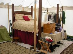 "Perry Dyer: ""Then there is the dropping six inches off the legs of the camping bed because it is a bit to high off the ground. Doing the finishing work for the canopy mounting and helping the Lady Love create curtains and canopy. Spec out a collapsible writing desk for the foot of the bed instead of the trestle table that sits there now."""
