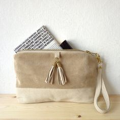 Natural leather purse / 100% repurposed beige leather / mini clutch bag / make up bag. $49.00, via Etsy.