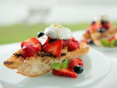 Sweet and Crispy Spiced Bread and Berries --- Brush ciabatta with melted butter, sugar and spices, then grill until toasted. Top with berries and whipped cream.