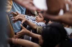 Internally displaced children scramble to get a piece of ice being handed out by aid workers at the Chota Lahore relief camp on May 2009 in Swabi, Pakistan. Social Injustice, Picture Editor, World Problems, In The Heart, Big Picture, Human Rights, Current Events, Couple Photos, Children