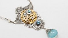 steampunk-necklace-gold-watch-movement-gears-blue-crystal-pearl-chalcedony-silver-filigree-statement-necklace-jewelry-207574254-1.jpg (350×200)