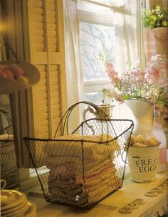 wire basket with folded linens