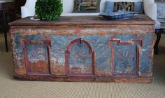 so like Annie Sloan, but not.. could be colors Aubusson Blue and Primer red over a rough hewn wood chest.