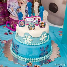 Bring out the coolest cake around! Rock candy, edible snowflakes & Frozen birthday candles turn an ordinary birthday cake into Elsa's ice castle! Click for how-to details!