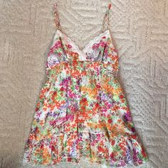 Tank top Baby doll multicolored flower tank top with lace on top, adjustable straps, ruched middle, lined, shell is 100% polyester and lining is 100% polyester, never worn. Forever 21 Tops Tank Tops