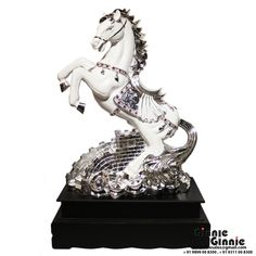 This Ginnie & Ginnie Exclusive Running Horse is a product from our Statue & Sculptures Collection. It is made of Polystone  and it got Marble look with Colored Electroplating finish on it. Its approx LxWxH is 21x12x32 inches. It is of approx 8110 grams. Unique Code of this product is M400457.32.SRE