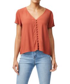 Elevate your basics with the Button Through Tee. This woven tee features V neckline, button front and relaxed fit.