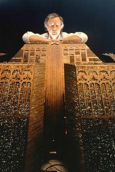 "Director Ridley Scott poses on set of ""Blade Runner"" in 1982."