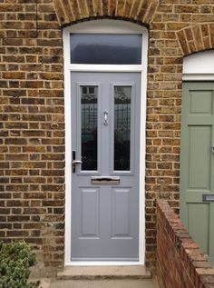 Enfield Windows recently fitted a Solidor composite front door to a property in Enfield, north London. We supply and fit composite doors in London Porch Windows, Front Door Porch, Porch Doors, Front Door Entrance, House Front Door, Windows And Doors, Door Entry, Front Porches, Grey Composite Front Door