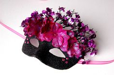 Black and fuchsia masquerade mask with crystals, sequins, and flowers