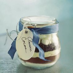 Layer the ingredients for homemade cocoa in a jar, add a ribbon and a tag, and you have a simple but stylish gift. This mix will fill a 1...