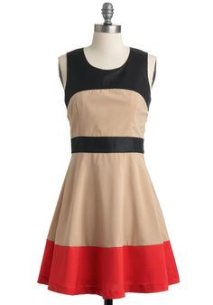 This colorblock shift features bands of bold black fabric printed with a leather-like sheen. These vegan faux leather accents accompany a stripe of red-orange trim that lines the hemline of this khaki dress