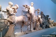 The Battle of Lapiths and Centaurs was depicted on the West Pediment. The version of Apollo, at center, was used on coins. Sculptures, Lion Sculpture, Ancient Greek Art, Centaur, Apollo, Olympia, Photo Galleries, Battle, Coins