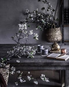 cherry blossoms & tea at the raw wood dining room table. wabi sabi. japan vibes photography & styling by Beth Kirby | localmilkblog.com | @local_milk #teatime #springflowers #slowliving